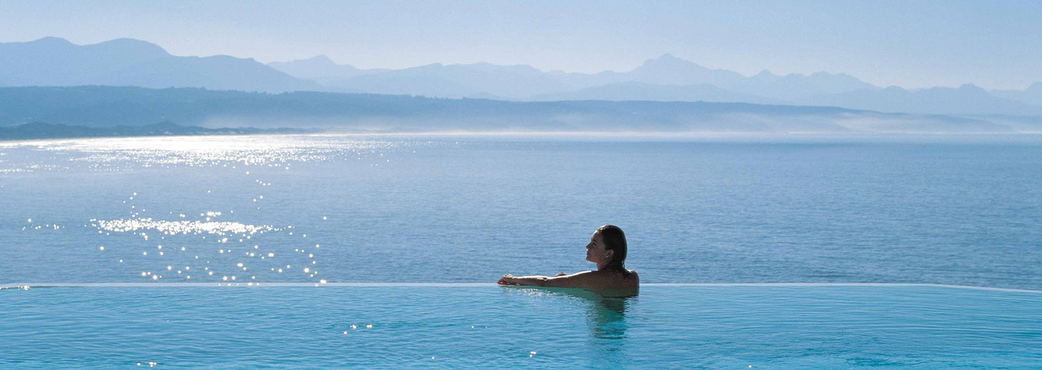 The Garden Route, woman swimming in infinity pool